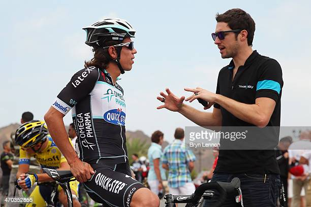 Team SKY Director Sportif Nicolas Portal chats to Rigoberto Uran of Colombia and Omega PharmaQuickStep at the start of stage two of the Tour of Oman...