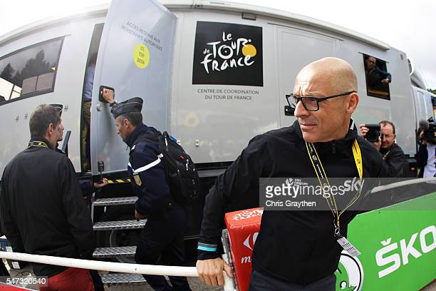 Team Sky Principal Sir Dave Brailsford walks out of the organisers office after stage twelve of the 2016 Le Tour de France, a 184 km stage from...