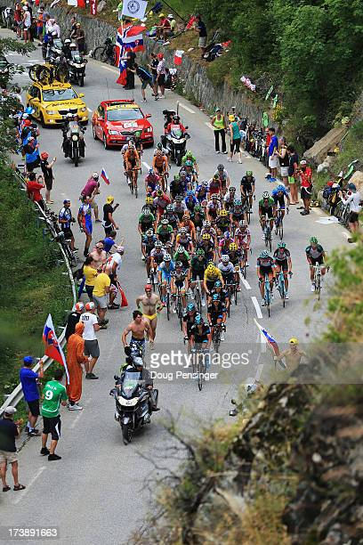 Team Sky Procycling ride at the head of the yellow jersey group to protect their leader Chris Froome during stage eighteen of the 2013 Tour de...