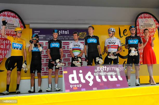 Team Sky Procycling riders Bradley Wiggins of Great Britain in the race leader's yellow jersey Richie Porte of Australia Christopher Froome of Great...