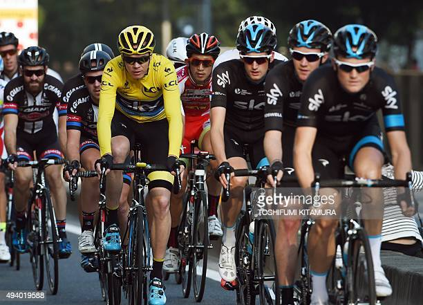 Team Sky rider Christopher Froome of Britain races with his teammates during the Saitama criterium main cycling race in Saitama on October 24 2015...