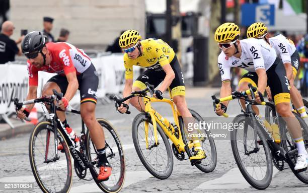 Team Sky rider Christopher Froome of Great Britain rides along the Avenue des ChampsElysees en route to winning the Tour de France in Paris France on...