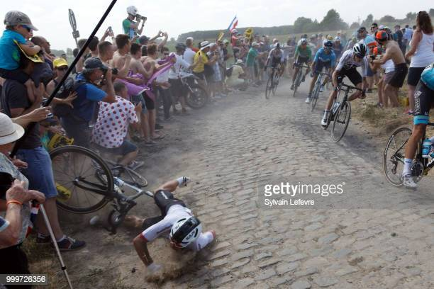 Team Sky rider Michal Kwiatkowski of Poland crashes at the 156.5-km of Tour de France 2018 stage 9 from Arras Citadelle to Roubaix on July 15, 2018...