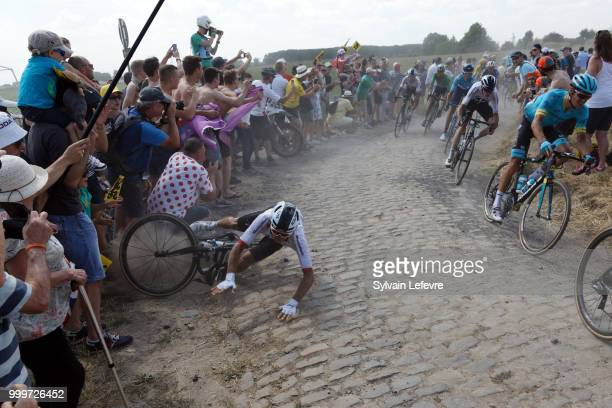 Team Sky rider Michal Kwiatkowski of Poland crashes at the 1565km of Tour de France 2018 stage 9 from Arras Citadelle to Roubaix on July 15 2018 in...