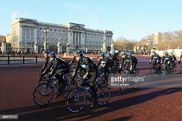 Team Sky riders lead a group of amateur cyclists past Buckingham Palace on January 4, 2010 in London, England.