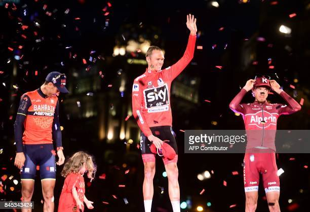 Team Sky's British cyclist Chris Froome celebrates on the podium winning the 72nd edition of 'La Vuelta' Tour of Spain cycling race between second...