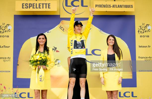 Team Sky's Geraint Thomas celebrates retaining the yellow jersey after stage 20 of the 2018 Tour de France
