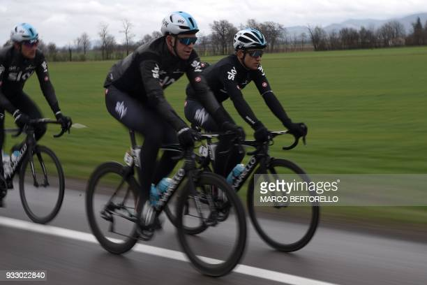 Team Sky's Polish rider Michal Kwiatkowski and British teammate Ian Stannard ride during the 109th edition of the Milan San Remo cycling race on...