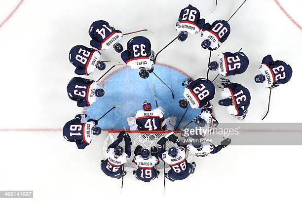 Team Slovakia gathers by the net prior to their Men's Ice Hockey Preliminary Round Group A game against USA on day six of the Sochi 2014 Winter...