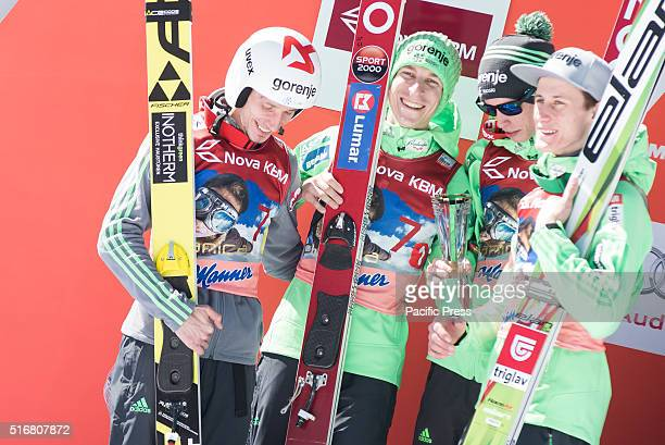 Team Slovenia on podium celebrating their second place at the Planica FIS Ski Jumping World Cup final