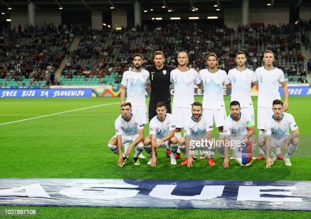 Team Slovenia posing for a group photo prior to the football match between National Teams of Slovenia and Bulgaria in Final Tournament of UEFA...