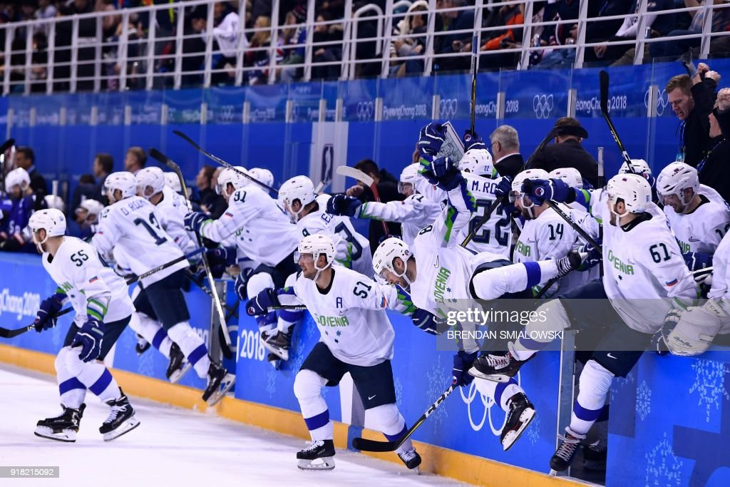 TOPSHOT - Team Slovenia rushes the ice after an overtime win of a men's preliminary round ice hockey match between the United States and Slovenia during the Pyeongchang 2018 Winter Olympic Games at the Kwandong Hockey Centre in Gangneung, South Korea on February 14, 2018. / AFP PHOTO / Brendan Smialowski