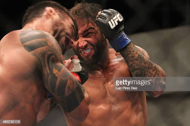 Team Sonnen fighter Guilherme de Vasconcelos punches Team Wanderlei fighter Ricardo Abreu in their middleweight fight during season three of The...