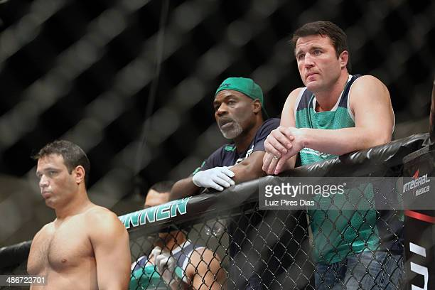 Team Sonnen fighter Job Kleber stands in his corner as Team Sonnen boxing coach Clayton Hires and coach Chael Sonnen stand above him before he faces...