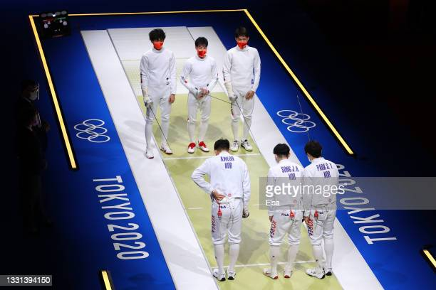 Team South Korea bows to Team Japan prior to their match in Men's Épée Team Semi-final on day seven of the Tokyo 2020 Olympic Games at Makuhari Messe...