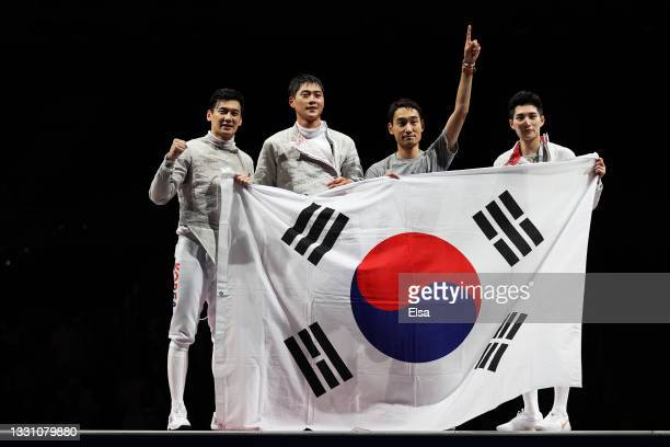 Team South Korea celebrate after defeating Team Italy during the Men's Sabre Team Gold Medal Match on day five of the Tokyo 2020 Olympic Games at...