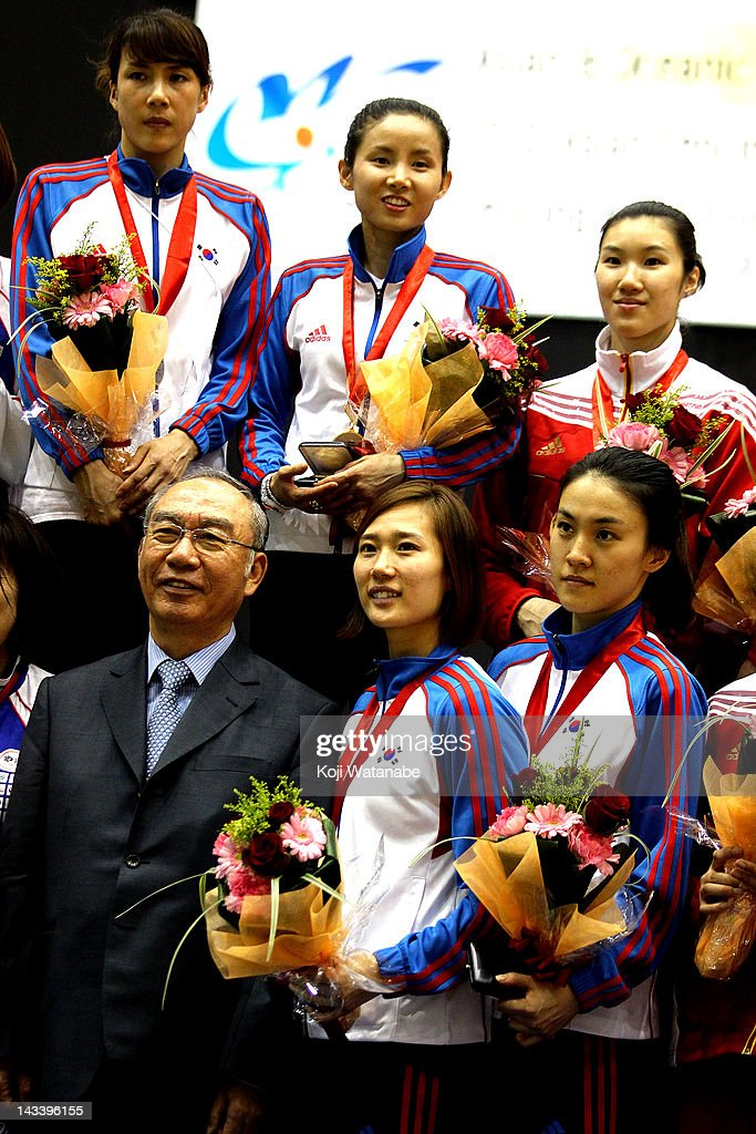 Team South Korea receives the gold medal on the winners podium after in the Women's Foil Team Tableau of final on day four of the 2012 Asian Fencing Championships at Wakayama Big Wave on April 25, 2012 in Wakayama, Japan.