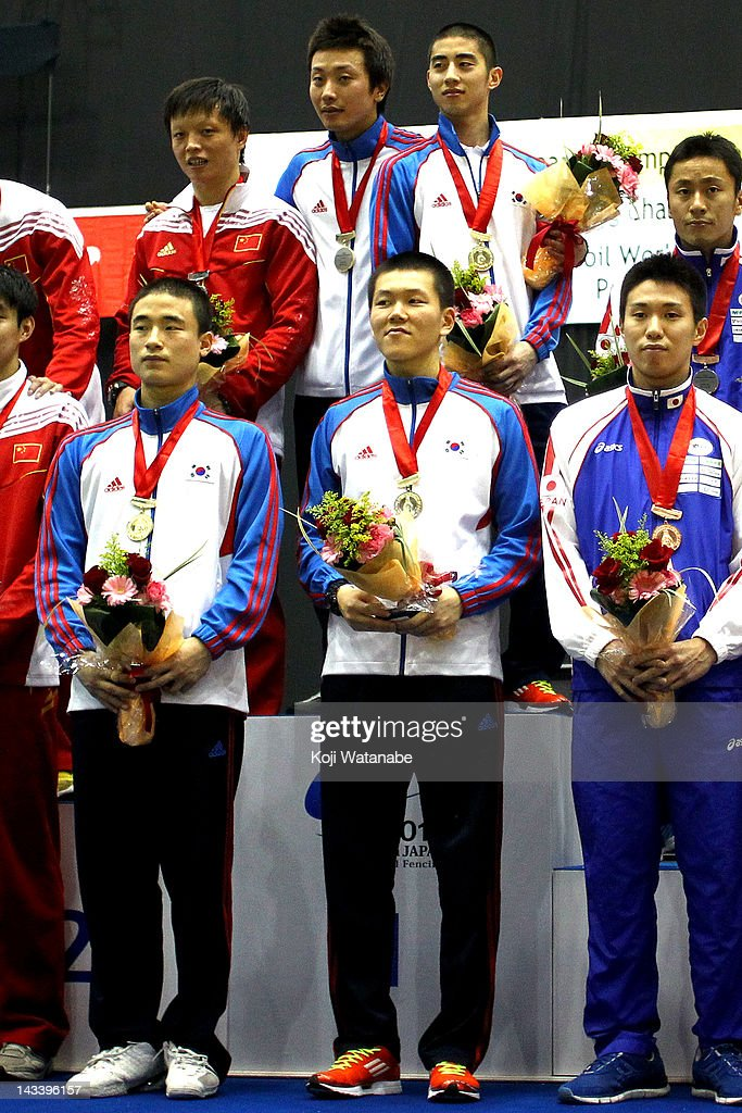 Team South Korea receives the gold medal on the winners podium after in the Men's Foil Team Tableau of final on day four of the 2012 Asian Fencing Championships at Wakayama Big Wave on April 25, 2012 in Wakayama, Japan.