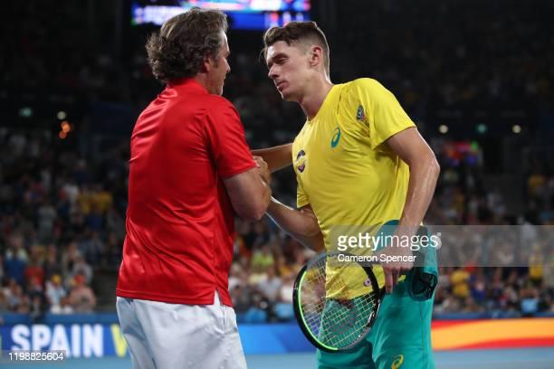 Team Spain captain Francisco Roig and Alex de Minaur of Australia shake hands after his semifinal singles match against Rafael Nadal of Spain on day...