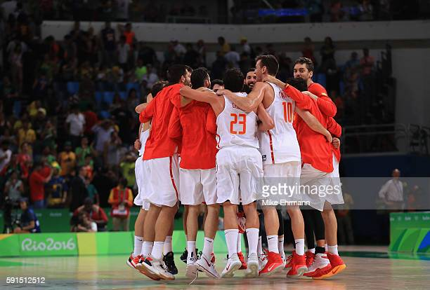 Team Spain celebrates after defeating France during the Men's Quarterfinal match on Day 12 of the Rio 2016 Olympic Games at Carioca Arena 1 on August...