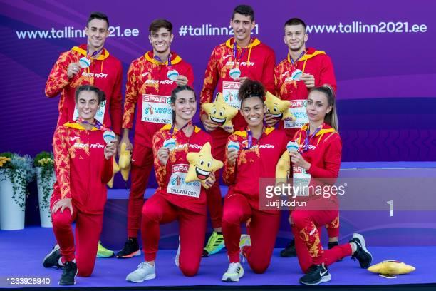 Team Spain with Aitana Rodrigo, Jael Bestue, Eva Santidrian, Carmen Marco,Arnau Monne, Pol Retamal, Jesus Gomez and Sergio Lopez pose with the silver...