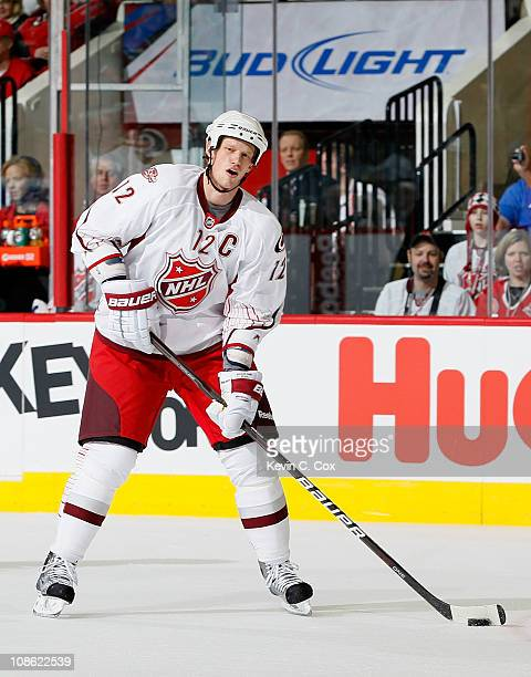 Team Staal player Eric Staal of the Carolina Hurricanes skates with the puck against Team Lidstrom in the 58th NHL AllStar Game at RBC Center on...