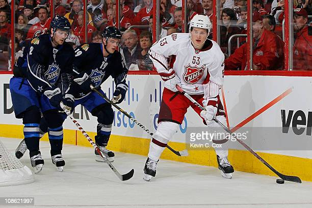 Team Staal player Jeff Skinner of the Carolina Hurricanes controls the puck against Team Lidstrom players Duncan Keith of of the Chicago Blackhawks...