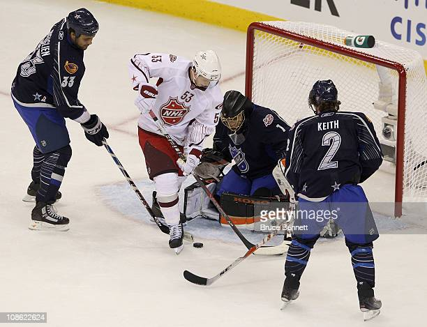 Team Staal player Jeff Skinner of the Carolina Hurricanes shoots against Team Lidstrom players Jonas Hiller of the Anaheim Ducks Duncan Keith of of...