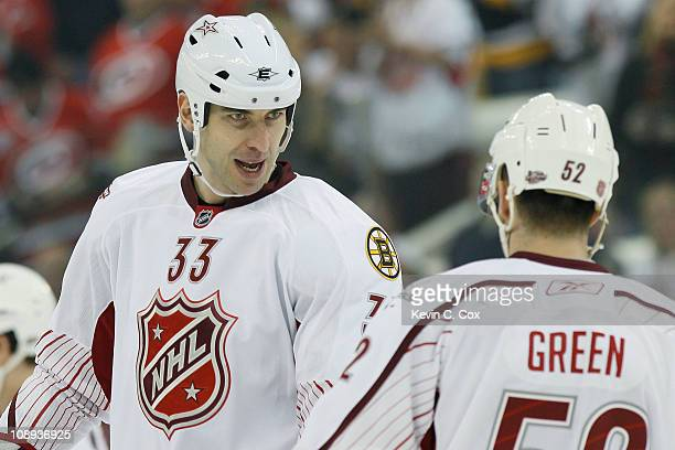 Team Staal players Zdeno Chara of the Boston Bruins and Mike Green of Washington Capitals react against Team Lidstrom in the 58th NHL AllStar Game at...