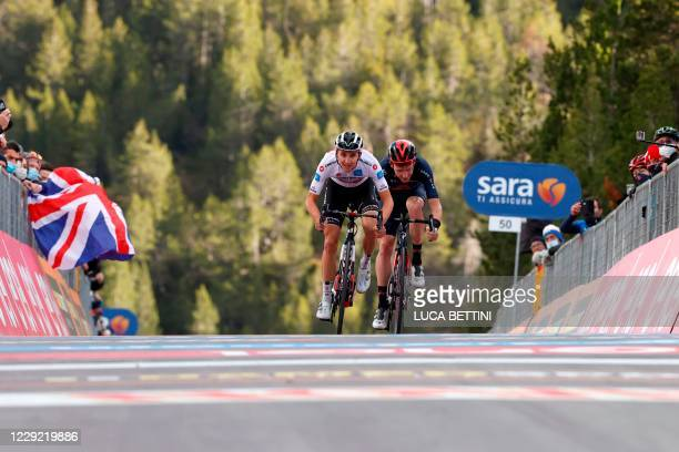Team Sunweb rider Australia's Jai Hindley sprints to cross the finish line ahead of Team Ineos rider Great Britain's Tao Geoghegan Hart and win the...