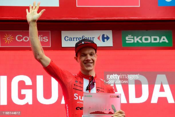 Team Sunweb rider Germany's Nikias Arndt celebrates on the podium after winning the eighth stage of the 2019 La Vuelta cycling tour of Spain, a 166,9...
