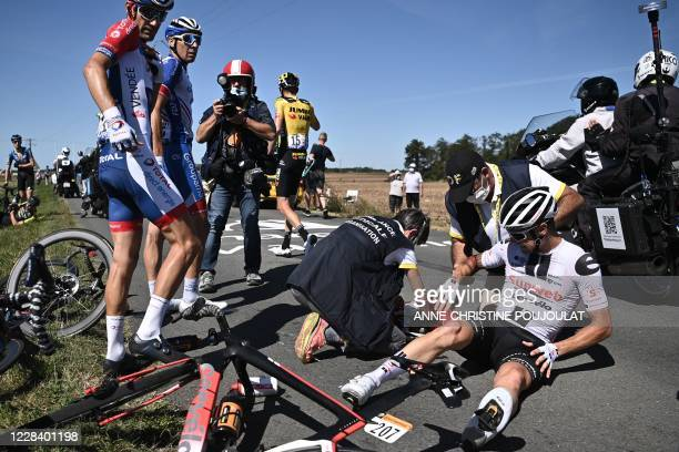 Team Sunweb rider Ireland's Nicolas Roche is helped by medics after crashing during the 10th stage of the 107th edition of the Tour de France cycling...