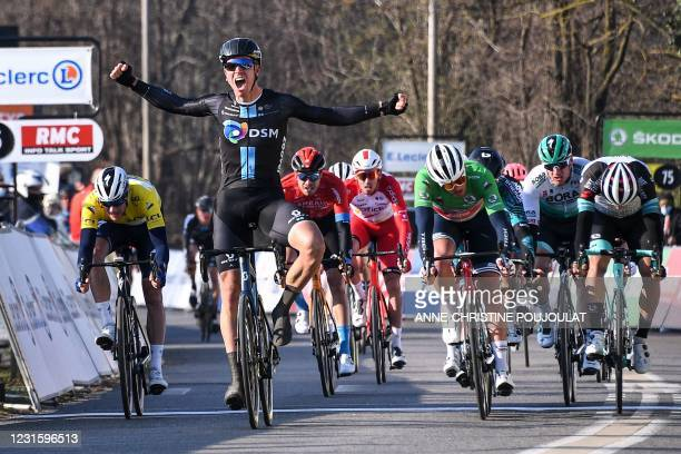 Team Sunweb rider Netherlands' Cees Bol celebrates as he crosses the finish line next to Team Trek rider Denmark's Mads Pedersen at the end of the...