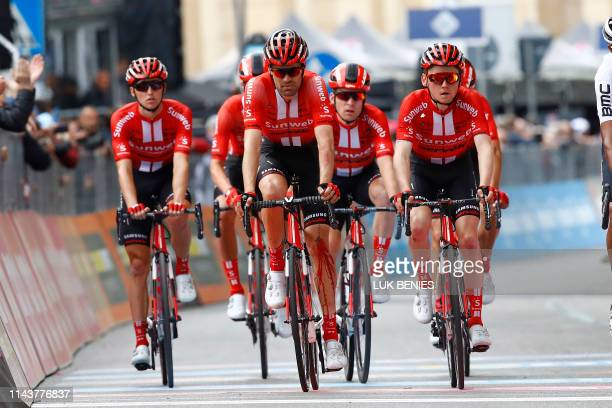 Team Sunweb rider Netherlands' Tom Dumoulin crossing the finish line with a knee bleeding after a crash during stage four of the 102nd Giro d'Italia...