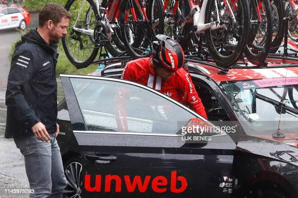 Team Sunweb rider Netherlands' Tom Dumoulin enters a car after abandoning the race during stage five of the 102nd Giro d'Italia - Tour of Italy -...