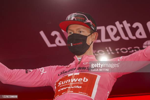 Team Sunweb rider Netherlands' Wilco Kelderman, wearing the overall leader's pink jersey, celebrates on the podium after the 19th stage of the Giro...