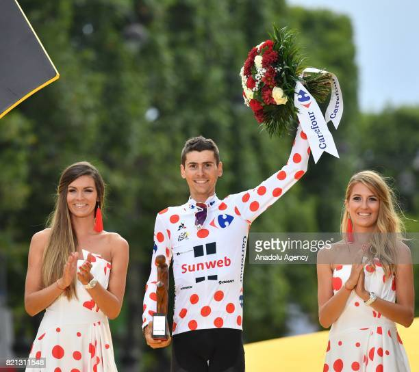 Team Sunweb rider Warren Barguil of France celebrates as the best climber on the podium after the Tour de France 2017 cycling race at the Avenue des...