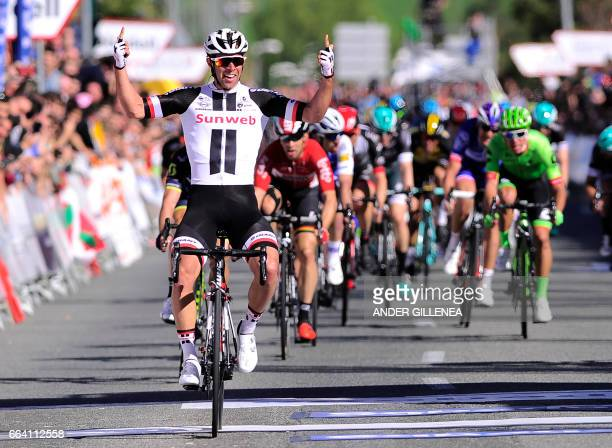 TOPSHOT Team Sunweb's Australian rider Michael Matthews celebrates as he crosses the finish line during the first stage of the 2017 Tour of the...