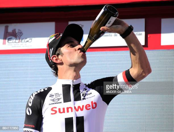 Team Sunweb's Australian rider Michael Matthews drinks Cava as he celebrates on the podium after winning the first stage of the 2017 Tour of the...