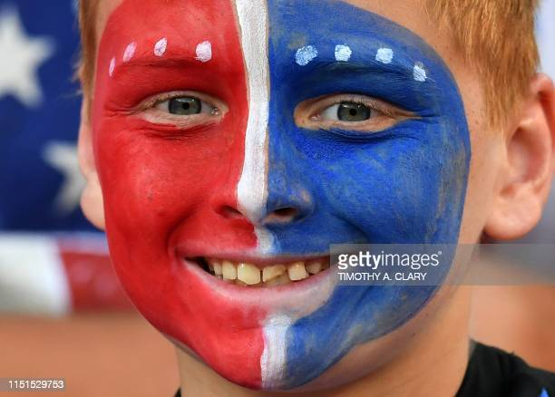 US team supporters attend their team's football match against Trinidad and Tobago during their CONCACAF Gold Cup group stage match at First Energy...