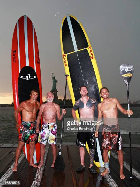 Team Surfing USA's Laird Hamilton Don Wildman Tim Commerford and Jason Winn relax at the completion of his crosscountry relay race at the Statue of...