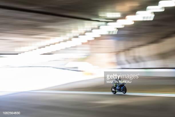 Team Suzuki Ecstar Italian rider Andrea Iannone participates in the third practice session ahead of the MotoGP Japanese Grand Prix at Twin Ring...