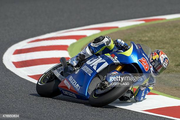 Team Suzuki Ecstar Spanish rider Maverick Vinales rides at the BarcelonaCatalunya racetrack in Montmelo near Barcelona on June 13 during the...