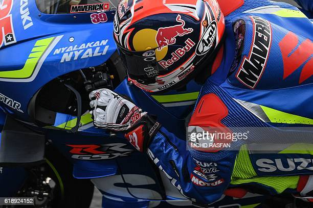 Team Suzuki Ecstar Spanish rider Maverick Vinales takes a corner during the third practice session of 2016 Malaysian MotoGP race at Sepang...