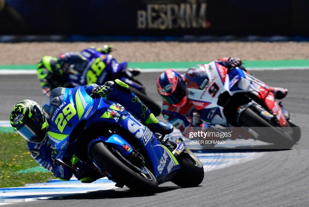 Team SUZUKI ECSTAR's Italian rider Andrea Iannone competes during the MotoGP race of the Spanish Grand Prix at the Jerez Angel Nieto racetrack in Jerez de la Frontera on May 6, 2018.