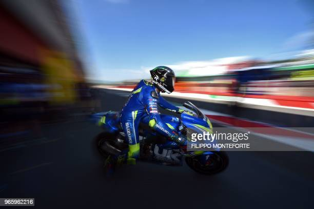 Team Suzuki Ecstar's Italian rider Andrea Iannone exits the pit lane during the free practice of the Moto GP of the Italian Grand Prix at the Mugello...
