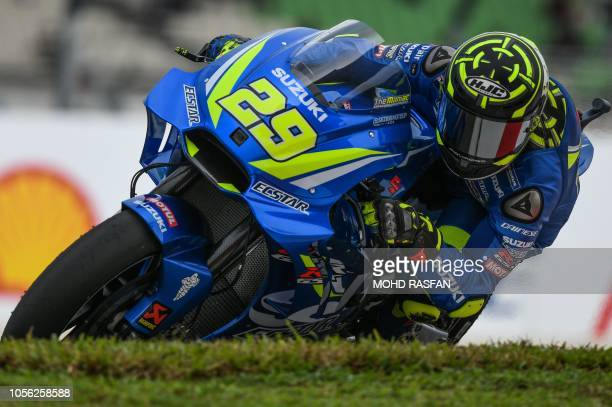 Team Suzuki Ecstar's Italian rider Andrea Iannone negotiates a corner during the second practice session of the Malaysia MotoGP at the Sepang...
