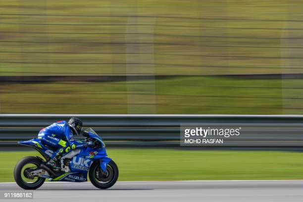Team Suzuki Ecstar's Italian rider Andrea Iannone steers his bike during the last day of the 2018 MotoGP pre-season test at the Sepang International...