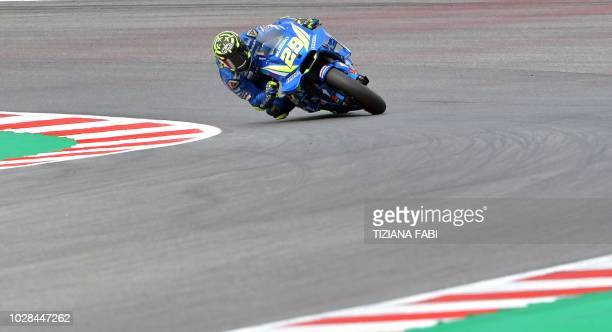 Team Suzuki Ecstar's Italian rider Andrea Iannone takes part in the free practice session of the San Marino Moto GP Grand Prix race at the Marco...