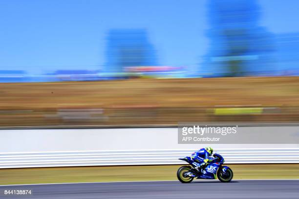 TOPSHOT Team Suzuki Ecstar's rider Andrea Iannone from Italy takes part in the free practice session at the Marco Simoncelli Circuit ahead of the San...